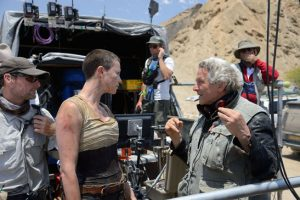 Charlize Theron and George Miller on set